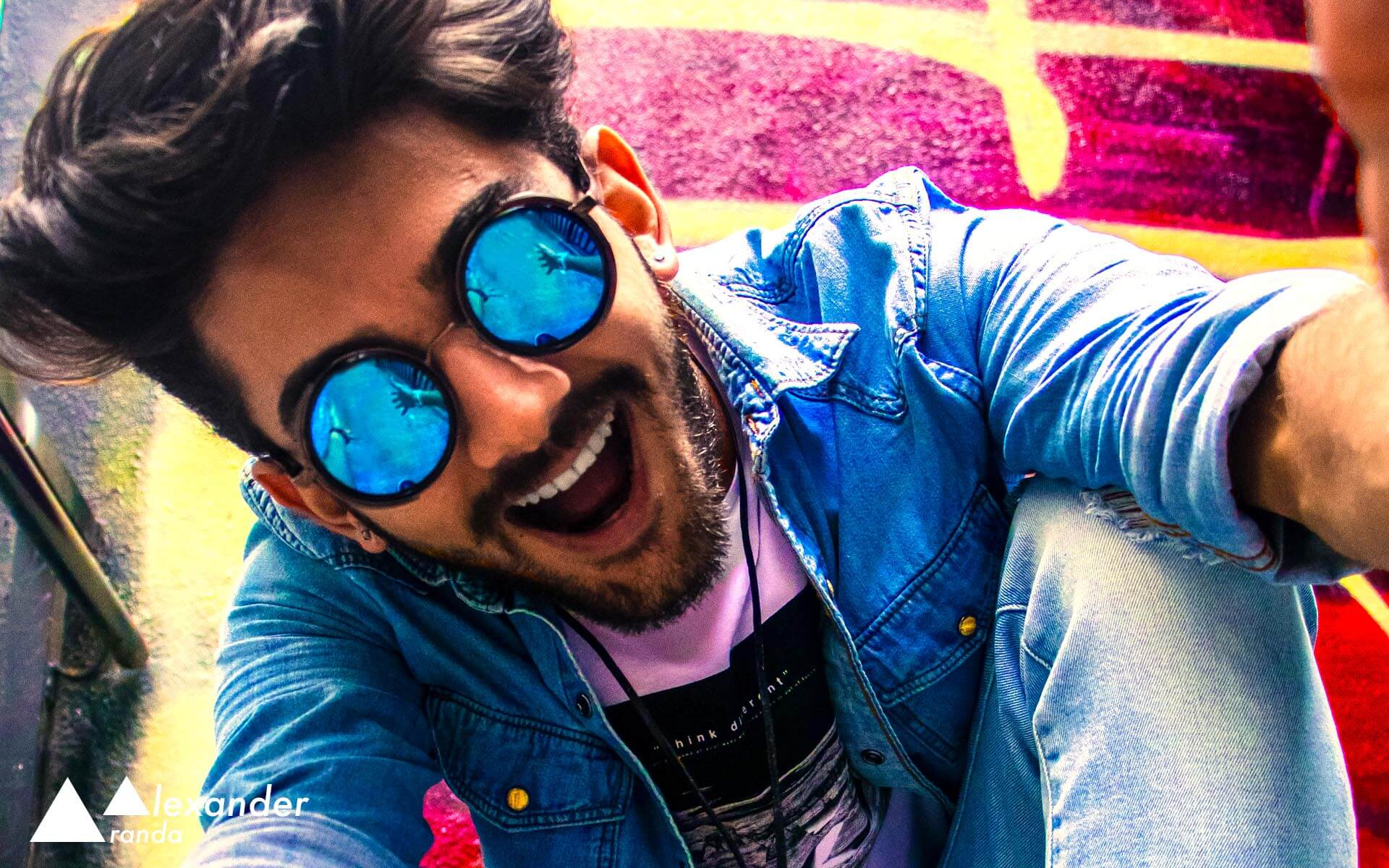 Fun picture of a guy with blue sunglasses