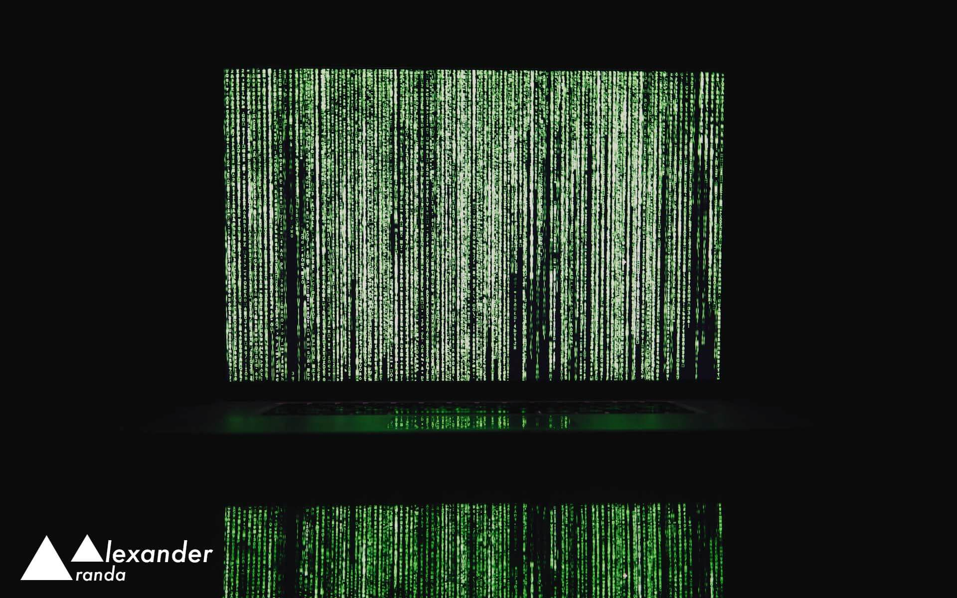 Laptop displaying falling green text from The Matrix movie